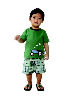 Give your little guy tractor style with a super cute tee and fun patchwork shorts. Flip flops offer a summery finish to his everyday look.