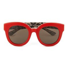 Women's 'Enchanted Garden' sunglasses from Dolce & Gabbana with plastic construction and round, slightly winged frame.  Showcasing a plain design to the outsid…