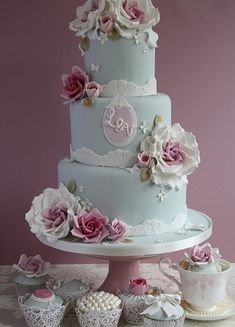 Pale blue #wedding #cake with pink roses and monogram. Reminds me of an extravagant and lovely tea party.