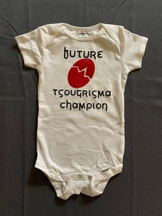 Excited to share this item from my shop: Future Tsougrisma Champion Onesie- Easter - Greek Easter- Traditions Carnival Crafts, Orthodox Easter, Greek Easter, Godmother Gifts, Baptism Favors, Godchild, Easter Traditions, Iron On Vinyl, Diy Flowers