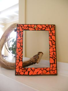 MY SISTER MADE THIS.....:) picture frame.... made with broken skeet pieces and a bullet shell on top