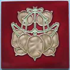 """Fantastic abstract art nouveau design on a red field from the Belgian firm, Hemixsem. The tile is in excellent condition; it has some wear to the raised line of the right-most """"flower"""" and light surface..."""
