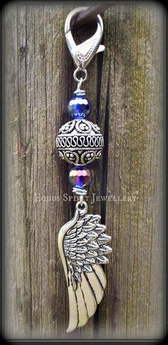 Purple beaded Bali style angel wing by EquusSpiritJewellery