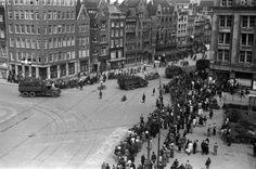 "May 9, 1945. Canadian armed forces escort German troops from the ""Groote Club"" on Damrak in Amsterdam to internment camps. Photo: Will F. Leijns #amsterdam #worldwar2"