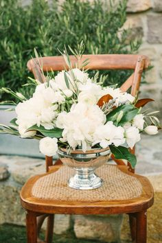 Stunning florals. #peonies #magnolia   Read more - http://www.stylemepretty.com/2014/01/17/elegant-farm-to-table-wedding-at-farmstead-restaurant/