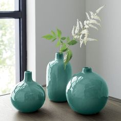 Turquoise bud vases from Crate