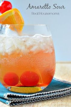 This classic Amaretto Sour is a popular cocktail. Combining citrus flavors with Amaretto and everyone's favorite maraschino cherries. #Realhousemoms #Cocktails #Amarettosour #Maraschinocherries #Celebrate