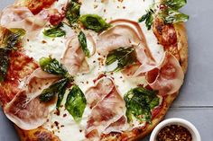The most decadent & delicious recipe for Burrata Pizza to even grace your kitchen! Topped with fried basil, red pepper flakes and prosciutto - it's perfect.