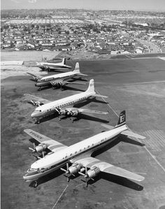 DC-7 thru DC-3 lined up in the sunup on the NE end of the airport. The view is looking towards the east. 1953 santamonicairport.info