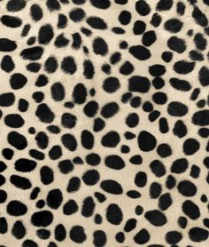 Shop  Taupe Dalmatian Velboa Faux Fur Fabric at onlinefabricstore.net for $7.2/ Yard. Best Price & Service.