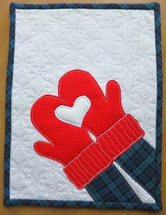 this is darling, I will make mine with the hands coming from each corner though, to cute! Heart in Mittens