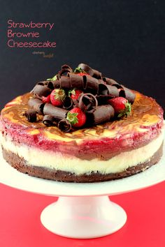 Fudgy Brownie base with layers of cheesecake and strawberry swirls. Topped with big chocolate curls and strawberries. from #dietersdownfall