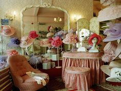 Photographer |  Maxine Beuret00120700 | Old Fashioned Milliner Hat And Glove Shop Interior With Dressing Table And Chairs.