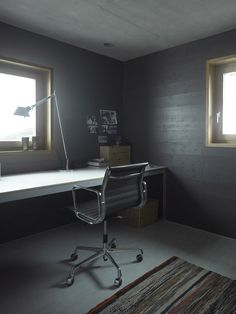 Architecture, Astounding Interior Design Featuring Modern Work Table With Cool Black Chair Lighted By Desk And Ceiling Lamp Black Wooden Paneling Wall Grey Floor Rug: Bed and Breakfast Design Completing Your Family Vacation in Vals