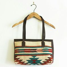 "Southwest aztec saddleblanket bag - shoulder Woven wool saddleblanket body panel. Vegan brown leather handles and side panels. Zipper closure. Fully lined. 13"" wide 8.5"" tall 11"" strap drop Vera Lyndon  Bags Shoulder Bags"