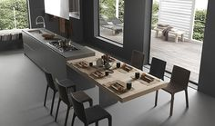 """MODULNOVA cucina """"Light"""" table bar abaissée et décalée par rapport à l'ilot du plan de travail. extensible"""