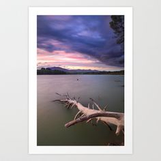 Windy sunset at the lake Art Print by Guido Montañés - $19.95