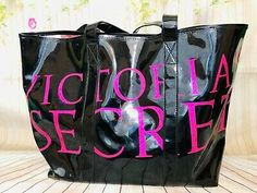 Victoria's Secret Large Black Vinyl Tote With Pink Glitter Letters. Tote has a white scuff on it.