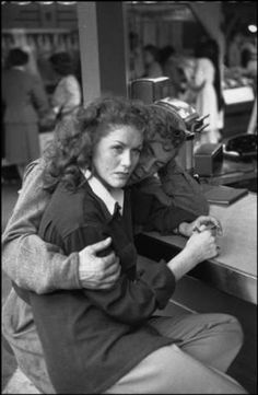 Farmers Market, Los Angeles 1947, photo by Henri Cartier-Bresson. I totally wonder what happened here.Whatever happened, you can tell she is NOT happy and her BF trying to console her is not working...
