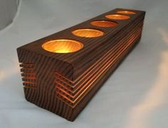 Each candle holder is made of roughly hewn wood, rustic and unique. The candles are sunk deep in this wood candle holder, so the graceful wood strips literally come with flickering lights by candlelight. It creates an effect like the glow of a fire, - Wooden Candle Holders, Candle Jars, Candleholders, Wooden Tea Light Holder, Fire Candle, Tea Candle Holders, Candle Store, Glass Candle, Candlesticks