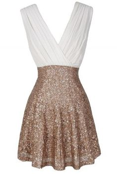 The Flash of Light Chiffon and Sequin Dress in Ivory/Gold is fun, festive, and flashy–and it retails for just $45.- possible rehearsal dinner dress?