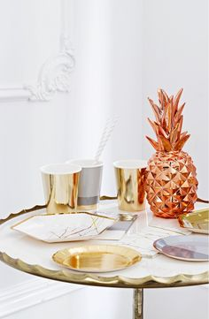 A shining copper finish illuminates this lovely resin pineapple decoration that makes a beautiful centerpiece—and a classic symbol of welcome.