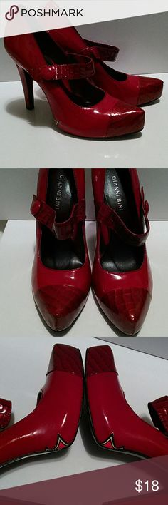 GIANNI BINI STILETTOS Size 8 1/2 M. 5 inch heels. Crocodile tips on the toes and the straps. Funky flame design on the side's. Beautiful condition. Super shiny. Pic 4 shows where they have been worn. Very minor. Yeah, go ahead, step out in these babies..... Gianni Bini Shoes Heels
