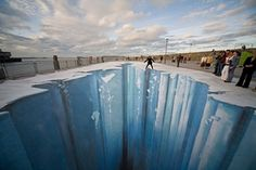 """DUN LAOGHAIRE, IRELAND - FEBRUARY 24:  The 3D street painting """"Crevasse"""" by artist Edgar Mueller is seen in this undated picture during the """"Festival of culture"""" from August 21-24, 2008 in Dun Laoghaire, Ireland. Edgar Mueller put a part of the eastern Pier into the ice age. This project has been supported by the Goethe Institution Germany."""