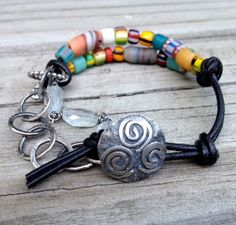BOHO Silver Leather BRACELET African Trade Bead Bracelet Funky Hippie multicolor Sundance Style Bracelet Adjustable by artdi on Etsy https://www.etsy.com/listing/200620994/boho-silver-leather-bracelet-african