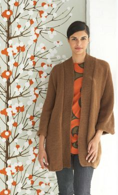 Long and modern, this chic sweater coat made with Wool-Ease is perfect for cool weather.