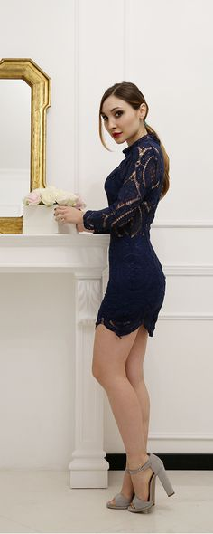 Street Style, 2015: She is wearing a Navy Long Sleeve Hollow Lace Dress with a pair of grey heels. It is beautiful!!!