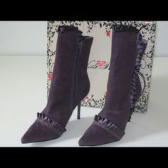 Wild Rose purple boots Wild Rose purple mico suede boots shaft approximately 8.5 from arch, heel 4 inches no platform  ruffles across the balance and around the boot with zipper. Nice trendy boots that you wear with a pair of leggings tights or a skirt AB Studio Shoes