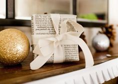 wrap boxes w/ simple bow in bread bowl-    48 Gorgeous Holiday Mantel Decorating Ideas | Midwest Living
