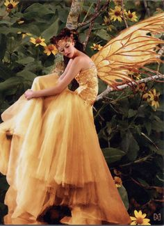 A beautiful fall fairy with wings the colors of autumn leaves