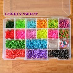 Please Like and Repin!  Loom Bands Storage Case / Organizer with 2200 loom band refills in 17 unique colors, 75 S-clips and 36 charms