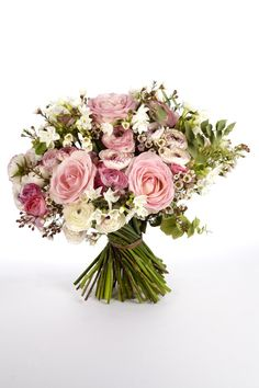 Pure romance ..... An extremely elegant soft pink bouquet, that dazzles with five charming types of flowers and sweetly scented foliage