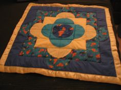 A baby quilt I made for a friend, a couple of years ago.