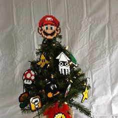 Product Details: This is a 100% handmade Mario tree topper! It is made out of plastic beads that have been fused together. It is about 4.5 inches