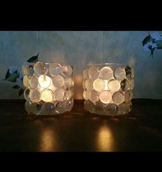 Dollar tree pebbles glued to glade candle holders rustic wedding