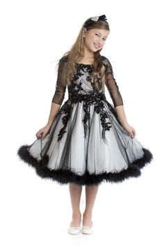 Luxury dress in black tulle with ivory lining. The 3/4 sleeves body is embroidered by hand with blacklaceflowers, crystals and feathers and wide full skirt is embellished by applying soft marabou feathers along the hem.DELIVERY 2/3 WEEKS