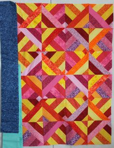 Art in search: 3 Dudes quilt - sew 6 strips together,  cut in squares, sew squares together on all sides with top square rotated 90 degrees and cut twice diagonally