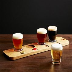 Pour your own brewpub-style flights with our exclusive gift-boxed beer sampling set. Four sculptural 8-ounce glasses rest in a tray embossed with bottle-cap numerals for identifying ales, pilsners, lagers and stouts. Substantial sham bases on the glasses fit neatly into cutouts on the beautiful acacia wood serving tray.