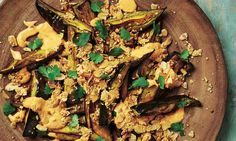Yotam Ottolenghi's roast aubergine with chilli yoghurt and paprika almonds.
