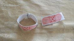 Playing doctor: DIY reusable pretend bandaids...get a white cuff or piece of white elastic, draw a bandaid shape with light orange sharpie and add detail with darker orange or red sharpie...