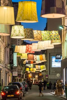 "2nd arrondissement - the ""Paris Deco Off 2013"".  Participating fabric houses each contributed a lamp shade to create this fantastic display down the rue du Mail on the right bank.  How fun!  How quirky!  How Paris!!"