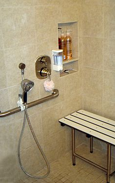 Not really universally designed b/c it looks kind of medical, but the seat and the shower head are in the right place.  Usually they are mounted in positions far apart so you can't adjust the temperature while you're seated.