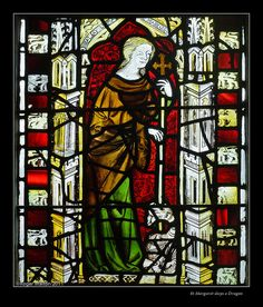 Detail from North Aisle, Middle Window - St Denys, York: C14th:  St  Margaret slaying a dragon.