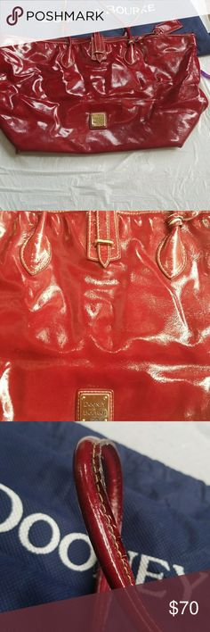 Purse Patent leather dark shiney burgundy. 1 corner n bottom of handles worn as shown in photos. Strap & snaps to hold closed. Key holder, ID tag on strap. No duster bag. Dooney & Bourke Bags Totes