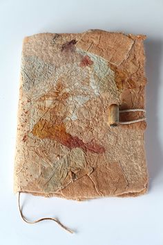 Nuno Felted Journal by Marina Shkolnik - rusty dyed fabric scraps (cotton, cotton lace, cotton gauze, silk, raw silk, chiffon), cotton, merino wool, jute cord, exotic wood bead, austrian paper.