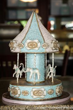 Beautiful Carousel-inspired baby shower cake! REPIN FOR GLOBEMED!